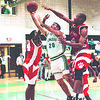1/28/97 NFHS at LewPort 2 - James Neiss Photo - Frank Garcia of LewPort puts one up in the 2nd QTR against Niagara Falls High School.<br /> Basketball<br /> Sports