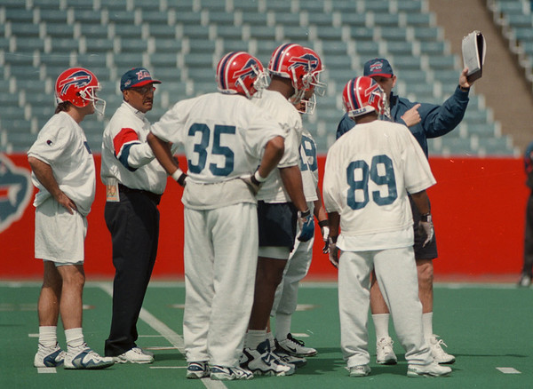98/04/25-- Bills camp2--Takaaki Iwabu photo-- Bills offensive players get some instruction from coaches during the mini camp at Rich Staduim