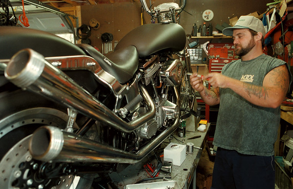 98/08/12--MOTORCYCLE GUY--DANC APPELLAZZO PHOTO--TIM WOODEAN, OWNER OF RANSOMVILLE CYCLE SERVICE , 3695 RANSOMVILLE RD., WORK ON A SUPERCHARGED HARLEY DAVISON IN HIS SHOP. <br /> <br /> GR