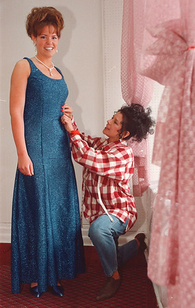 4/17/97-- prom dress-- Takaaki Iwabu photo-- Karen Catino, owner of Your Dreams Come True Bridal By Karen , gives a final touch on the dress she makes. Modeling for a picture is Amy Consier, NIagara Wheatfield High School's senior, who is getting ready for her prom. <br /> <br /> Sunday, feature, color