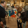 98/04/16--JENSS--DAN CAPPELLAZZO PHOTO--LEWIS PIRASTRU, YOUNGSTOWN, LOOKS ON AS HIS DAUGHTER DAUREEN SCHULTZ, N.F. TRIES A MARKED DOWN COAT OF HER 4-YR-OLD SON NATHAN AT THE SUMMIT JENSS.<br /> <br /> 1A