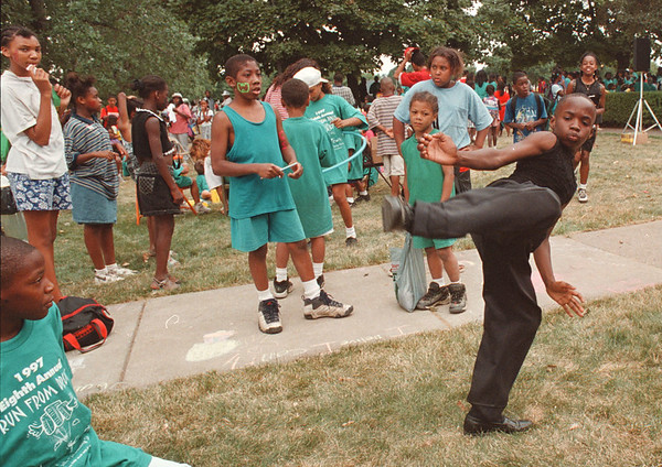 8/1/97 run from drug--Takaaki Iwabu photo-- Donte Shackelford, 11, shows off his marshall art skill at the gathering in front of Center Court Project after the 8th Annual Run From Drugs race Friday.<br /> <br /> Local, Saturday, bw