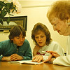 1/30/97--literacy class--Takaaki Iwabu photo--Margaret Meteer, right, a literacy volunteer at Lewiston Library, teaches to John and Mary Miller in the Library Thursday. <br /> <br /> feature, Thursday