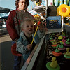98/06/04 Hyde Park Fair-Rachel Naber Photo-David Yarger marvels at his pinwheel won by picking three ducks out of the pond with his mother Tracie Yarger.