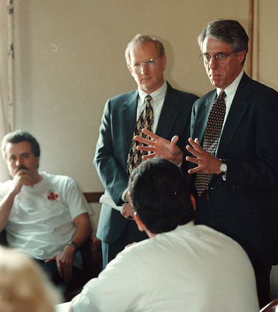 6/10/97-- presentation --Takaaki Iwabu Photo-- William Gay and Richard Brady from David M. Griffith Assocates, Ltd. make a presentation at Tuesday's City Counsil meeting in City Hall. Listening to them, at left, is Stefan Kundl, Niagara Falls Fire Officers Association President. <br /> <br /> local, bw, Wednesday