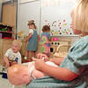 98/09/11 Pre-K Start-rachel naber Photo-(left to right) Nicholas Fresch, Kelsey Stanley and Shelby Roy and maggie Glenn pretend to play house at on the second day of pre-kindergarten at Charles Upson Elementary. Students learn vital skills such as socialization and through playing at the various stations.