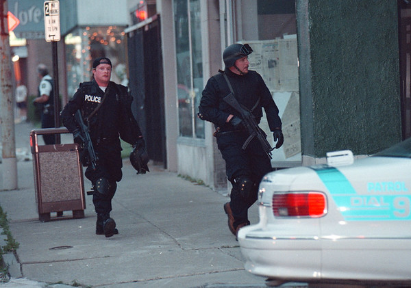 7/1/97--ARMED STANDOFF 2--DAN CAPPELLAZZO Photo--OFFICERS WITH THE NF TACTICAL UNIT ROUND THE CORNER OF 3RD AND FERRY AS THEY GET INTO POSITION AT 318 FERRY WHERE IS WAS BELIEVED THAT AN ARNED 20 YR-OLD WHITE MALE WAS HOLD UP WITH A NUMBER OF WEAPONS.<br /> <br /> 1A