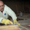 98/04/27 Corrosion Control-Marc Petrin an employee of Corrosion Control molds fiberglass material over wood forms to make fiberglass pipes.