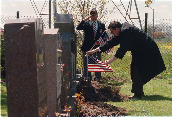 5/22/97 Memorial Day Preparation - James Neiss Photo - L-R - Arsen Garijanian, Past County Commander of the Lewiston post # 1083 of the American Legion and Bryant Kurtzman, Past President of Temple Beth Israel, place flags on veterans graves at the Beth Israel Cemetery in Lewiston.