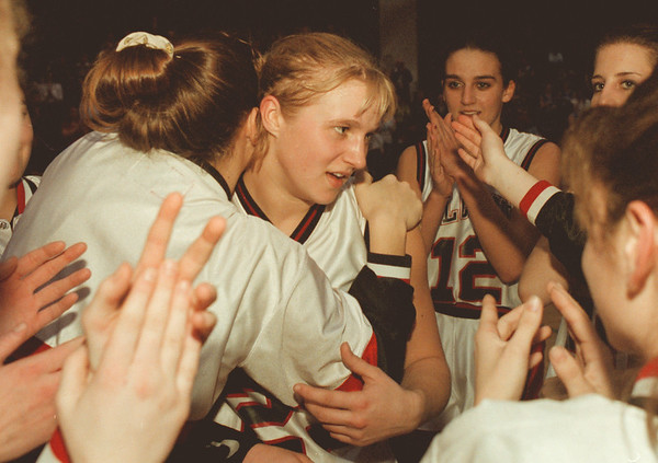 98/01/06--A. Tylec --Takaaki Iwabu photo-- Niagara Wheatfield HS basketball star Angela Tylec was surrounded by her teammates after she broke the school record (of pointing) during Monday's game againt Grand Island HS. <br /> <br /> sports, color Tuesday