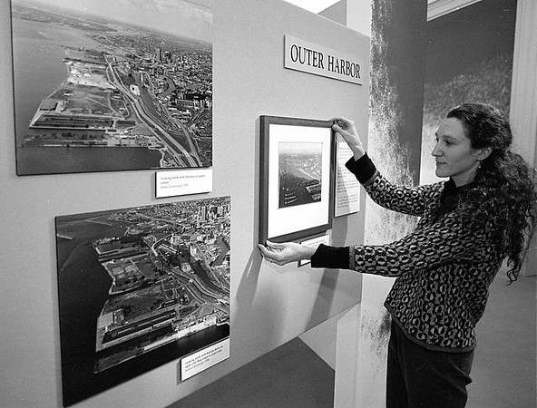 """3/19/97--HISTORICAL MUSEUM--DAN CAPPELLAZZO PHOTO--JUDY JUNGLE OF THE BFLO HISTORICAL MUSUEM HANDS  THE """"OUTER HARBOR"""" PORTION ON  THE CHANGES EXHIBIT.<br /> <br /> FRI FEATURE"""