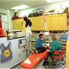 98/11/06 Happy Place *Dennis Stierer Photo -<br /> The office of Dr. Louis A. Surace, a Pediatric Dentist in Lockport is friendly, happy and a very colorful place to work and come to get your teeth cleaned and repaired. Dr. Surace along with Hygienist, Chris Hickman goes over some final cleaning on a patient named Andrew Cobb, 3.