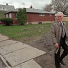98/04/01--MURDER/LINWOOD--DAN CAPPELLAZZO PHOTO--NF DETECTIVE FRANK CONEY  LEAVES 717 LINWOOD (RED BRICK) TO CANVAS THE AREA FOR LEADS. THE ELDERLY WOMAN FOUND DEAD AT 717 IS RULED A HOMICDE.<br /> <br /> 1A