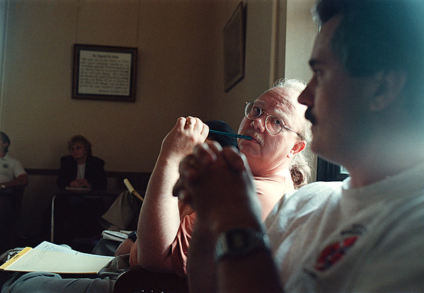 6/10/97-- p. bradley--Takaaki Iwabu photo-- Pat Bradley, columnist of Niagara Gazette, gives a skeptical look to everybody attending City Council meeting at City Hall.