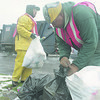 1/2/97 garbege, color--Takaaki Iwabu photo-- Allen Seefeldt, left, and Charles Mixon, employees of Modern Disposal Servieces, collects the trash bags on 72nd Street Thursday. <br /> <br /> 1A, Friday