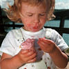 98/07/26 Cool Thing4-Rachel Naber photo-Gabrielle Bowden of Lockport inspects her favorite cherry flavor ice cream at Lewiston landing.