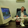 98/08/04 Sale Impact - James Neiss Photo -  Lockport stock borker, L. Mark Huntington, VP of Bodell Overcash Anderson goes over the days finantial figures. Some are wondering what the sale of Delphi will do to stock prices.
