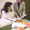 1/16/97--NC HEALTH/AIDS--CAPPY PHOTO--(LTOR)COMMUNITY HEALTH NURSE LINDA LOW AND SUPERVIOR COMMUNTIY HEALTH NURSE MARIE KARAMANSKI GO OVER SEXUAL HEALTH LITURATURE AT THE  NIAGARA COUNTY SOCIAL SERVICES BLDG.<br /> <br /> 1A TUESDAY
