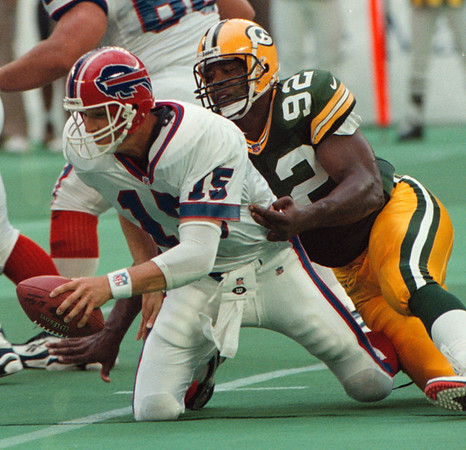 8/16/97--BILLS MAIN ACTION--DAN CAPPELLAZZO PHOTO--GREENBAY PACKERS ALL PRO REGGIE WHITE SACKS BILLS QB TODD COLLINS IN THE FIRST QUARTER.<br /> <br /> SP