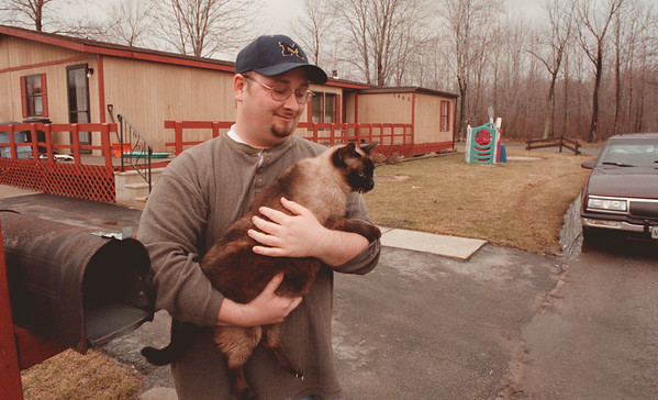 98/03/02--FLOOD/RETRO--DAN CAPPELLAZZO PHOTO--GARY SMITH, 1460 ELDERBERRY HOLDS THE CAT HE RESCUED FROM HIS HOME DURING THE FLOOD.<br /> <br /> 1A