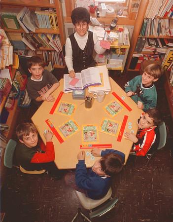1/27/97 School Reportcard - James Neiss Photo - Errick Road Elementary reading class - Clockwise from teacher are, Marge Serio, Reading teacher, Erik Kastner 7, Michael Folino 7, Steven Johnstone 8, Jerry Lasher 8 and David Lacomb 7.