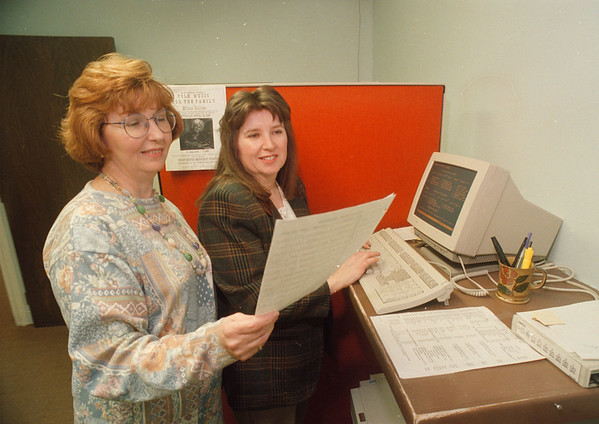 3/24/97 Social Services - James Neiss Photo - L-R - Bonnie Quaranta, Niagara County Social Services Commissioner, works with Typist Janet Pardee who will now be able to come in earlier to use the computer durring off peak times, getting more work done avoiding network traffic jams.