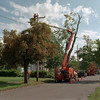 98/09/07 Restoring Power *Dennis Stierer Photo -<br /> Niagara Mohawk crews were very busy on Monday in Albion as these workers were on Clinton St. working to restore power.