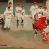 98/05/06--HS baseball 1--Takaaki Iwabu photo-- Niagara-Wheatfield Mike Ranalli, left, slides into home after he dodged a tug from Niagara Falls' Tom Dresman. Falcons won the game. <br /> <br /> sports, Thursday, color