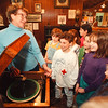 5/1/97 Vee Housman - James Neiss Photo - Vee Housman, a Volunteer with the Youngstown Historical  shows 4th grade LewPort North Elementary studenst a Victrola and plays a disk durring a field trip.