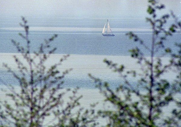98/05/06 Sailing By Olcott *Dennis Stierer Photo - A lone sailor passes by Olcott on a beautiful afternoon.