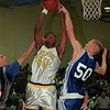 """97/12/05--LOCKPORT HOOPS--DAN CAPPELLAZZO PHOTO--LOCKPORT SR. JASON CHAFFIN HITS THE BOARDS AGAINST FRONTIER'S JOSH BECKER (RIGHT) AND JEFF PTAK IN FIRST HALF ACTION.<br /> <br /> SP/B&W 2 COL x 5"""""""