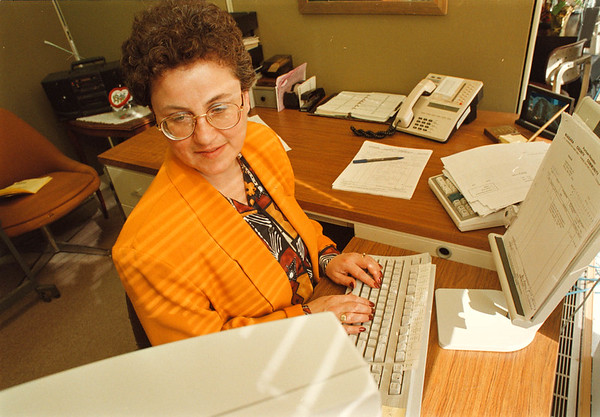 2/28/97-- Seland --Takaaki Iwabu photo-- Sharon Seland, principal cleark of Purchasing Department at Niagara County Community College, works at her office (pic for story about comp. time.... by Judy K.)<br /> <br /> 1A, Tuesday, topic