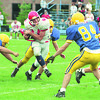 97/09/13 NF vs Lockport 2 - James Neiss Photo - #14 Thomas Kresman of Niagara Falls tries to avoid  the rush durring the 2nd qtr against Lockport.