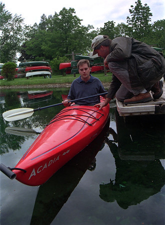 98/06/02 Kayak 4 Mark-Rachel Naber Photo-Kevin Burg (left) of Amherst came to test out the canoes Todd Finley has on hand.