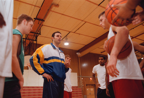 98/12/03 Mike Esposito - Vino Wong Photo - Coach Mike Esposito of NCCC speaks to his players about a previous game plan at the Starpoint Central School Thursday.