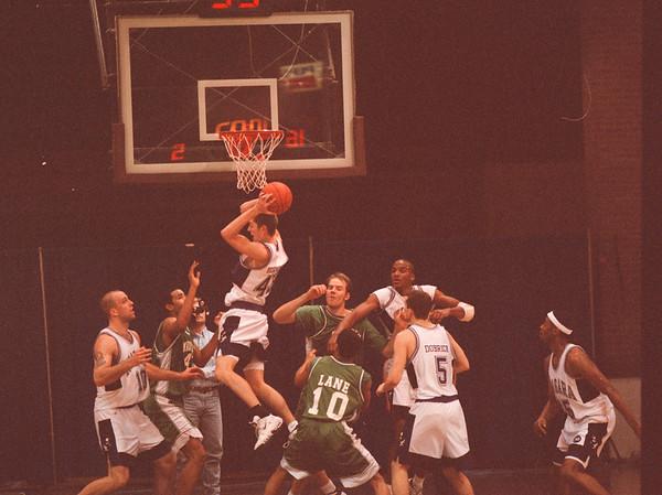 98/02/13 Eagles Rebound *Dennis Stierer Photo - Nate Bernosky #43  for Niagara gets the rebound after a failed Manhattan shot.