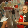 97/09/19 Auction --Takaaki Iwabu photo-- Volunteer Paul Dunlap passes out Chinese-auction tickets to the visitors of 15th Annual Festival of Light Auction at Niagara Falls Convention & Civic Center Friday. <br /> <br /> local, Saturday, bw