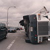 2/27/97-- wind accident 1-- Takaaki Iwabu photo-- High wind forced over the 18-wheeler truck on the top of the Grand Island Bridge (North Bound).