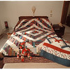 97/10/01 Quilters 5 - James Neiss Photo - Strip Pieced Half Log Cabin Quilt.