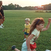 6/24/97-- sunset field --Takaaki Iwabu photo-- Tony Ventresca, left, took his children to the quiet baseball field on Niagara University's Deveaux Campus before the sunset Tuesday. Running around are, from left, Spencer, 2, Nikita, 6, and Shana, 5. <br /> <br /> grapevine photo