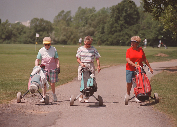 6/16/97 Golf Story - James Neiss Photo - L-R - Sylvia MacKender of NF, Sally Dworak of Lewiston and Laura Martinez of NF, all enjoy the nice warm day with a round of golf at the Hyde Park Golf Course.