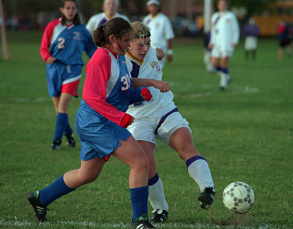 98/10/01 Albion Girls Soccer *Dennis Stierer Photo -<br /> Medina's #33, Elizabeth Tee is trying to get the ball from Albion's #24 Kerri Ernewein.