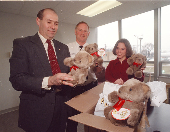 3/21/97 Helping Hugs - James Neiss Photo - Niagara County Sheriff Thomas A. Beilein, Mark S. Dembitsky, Director of Code Enforcement and Julie A. Vogt,  Domestic Violence <br /> Coordinator.  (Dembitsky was the liaison between the county and Target Market)
