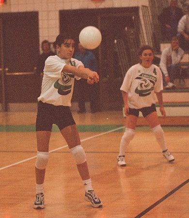 97/09/23 Lewport vs Lockport2 - James Neiss Photo - LewPort #15 robin Simonson sets up the ball durring the second game against Lockport. #4 Kacey Martinez is in the background to right.
