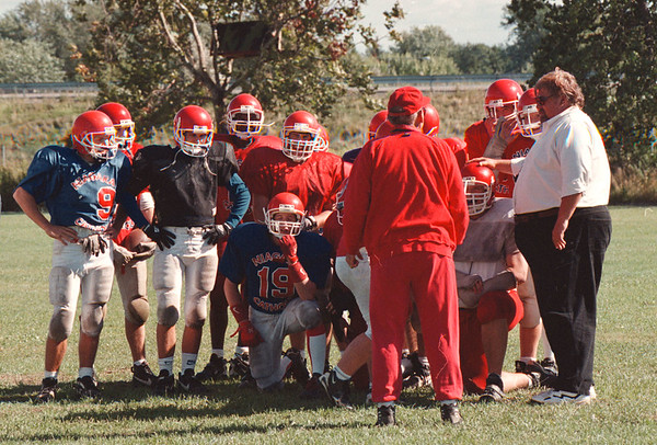 97/09/03--N.C. FOOTBALL 2--DAN CAPPELLAZZO PHOTO--N.C. COACH TED MAYERS  FAR RIGHT)(????/SEE STABA) TALKS TO HIS PLAYERS.<br /> <br /> SP