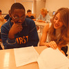 7/24/97--NF MIDDLE/NU TUTORS--DAN CAPPELLAZZO PHOTO--NU JR/ENGLISH EDUCATION MAJOR JULIE WNUKOWSKI GOES OVER NF MIDDLE SCHHOL 8TH GRADER JONATHAN RIVERS REPORT DURING A TUTORIAL SESSION AT SUMMER SCHOOL.<br /> <br /> SAT LOCAL