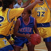 98/12/11 Medina G Hoops-Rachel naber Photo-Helen King (#12/ middle) of medina is covered by Buffalo Traditional players Amanda Artis (#42/left) , (#24??/middle) and Alohndra Brown (#32/right) but still manages to score in the last few seconds of the second half.