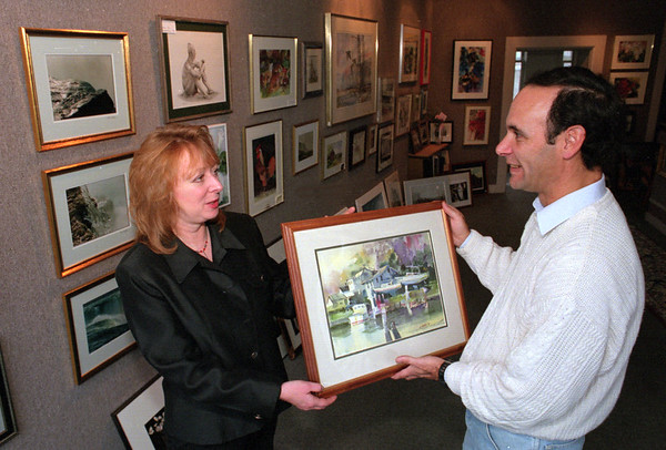 98/11/05 Art Loft *Dennis Stierer Photo -<br /> The Art Loft at 12 W. Main St., Lockport, is a new gallery that will feature the talents of many local artists and is set to have an Opening Celebration on Friday, Nov 13th from 7-10PM. Shown is Terri Seddon, the owner talking with well known artist Jeff Watkins about some of his new work.