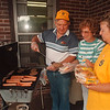 97/08/21 Lions Senior Picnic - James Neiss Photo - Town of Niagara Lions and Lioness's host Picnic for Senior Citizens. Here, L-R, Bob Shibely, Lions Treasurer, Jackie Teixeira, President of LionessÕs and jean Pasek, President elect get the burgers and dogs ready to eat... see attached release.