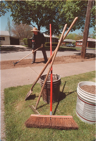 5/22/97 Grading the Lawn - James Neiss Photo - John Tubinis of 68th Street was fixing a unsightly bump that he in his lawn for the past 12 years. Said it was getting to be a problem wile cutting the lawn so decided to fix it before the Memorial Day Weekend.